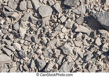 Closeup of stony ground creating abstract background wallpaper texture