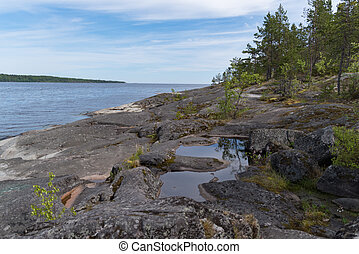 Stony lake shore on Great Ladoga Trail. Leningrad region. Russia.