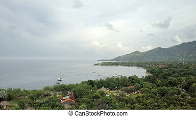 Stony seacoast and mountains . Indonesia. Bali.Aerial view...