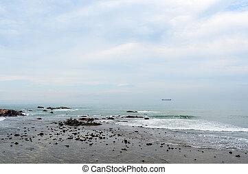 Stony shore with misty sea and sky - Stony shore with misty ...
