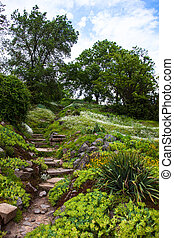 Stony stairs in the green garden