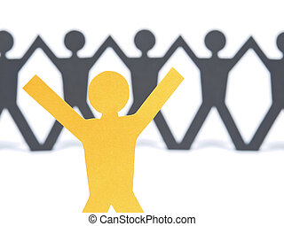 A yellow paper figure raising his arms. A paper man chain against the white background. Selective focus on the foreground.
