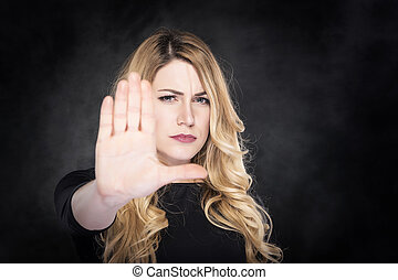 Stop abusing women. - Girl shows stop sign - extended hand....