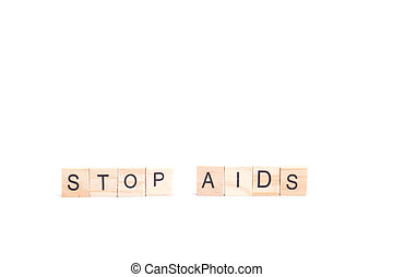 STOP AIDS word on square tile concept isolated on white background