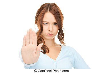 stop! - bright picture of young woman making stop gesture