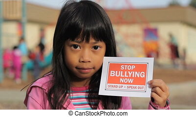 Stop Bullying Now Message-Close Up - A cute little Asian...
