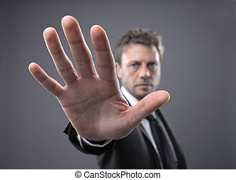 Stop - Businessman in a suit, gesturing stop