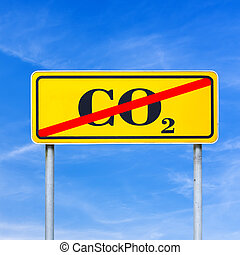 Stop CO2 emissions - CO2 sign crossed off on a yellow road...