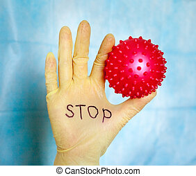Stop Covid-19. Text on medical glove.