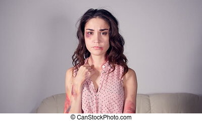 Stop Domestic violence and abuse. Woman with grazes and...