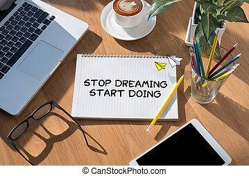Stop Dreaming Start Doing open book on table and coffee ...