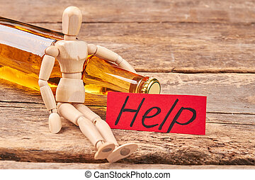 Stop drinking message, wooden dummy.