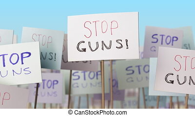 STOP GUNS placards at street demonstration. Conceptual loopable animation