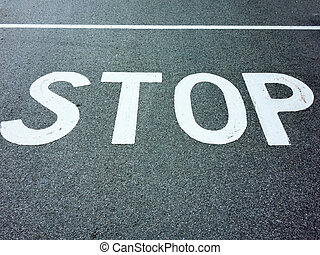 stop inscription on a road