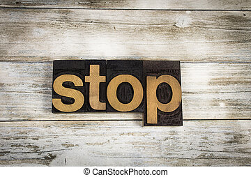Stop Letterpress Word on Wooden Background
