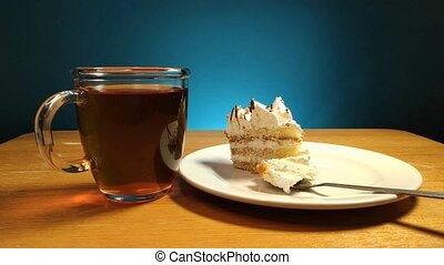 Stop motion animation of eating a piece of cake with a spoon on the table.
