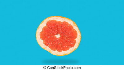 stop motion animation of fresh grapefruit disappears, appears on a blue background