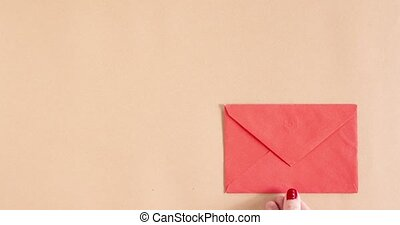 Stop motion animation with hearts getting out of envelope. Copy space. Love, valentine day, mothers day greeting card concept
