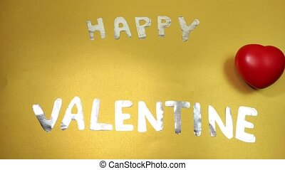 Stop motion animation with letters folding into the inscription Happy Valentine.