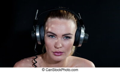 stop motion closeup of a woman with changing retro headphones