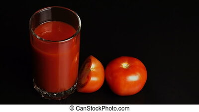 Stop motion concept cutting red tomato and juicy