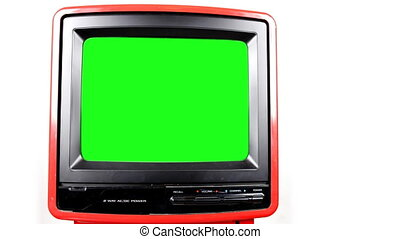 Stop motion of a fantastic retro red television spinning around with green screen in the tv for your OWN animations and videos
