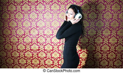 stop motion of a sexy woman dances with retro white headphones against a classic wallpaper print