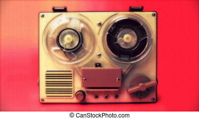 stop-motion of a small vintage reel to reel tape recorder...