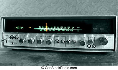stop motion of a vintage radio receiver with frequency dial moving with a funky wallpaper background