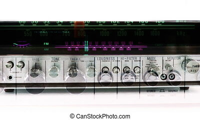 stop motion of a vintage radio receiver with frequency dial...