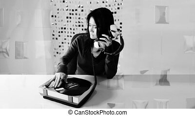 stop motion of a woman listening to music on a retro record player
