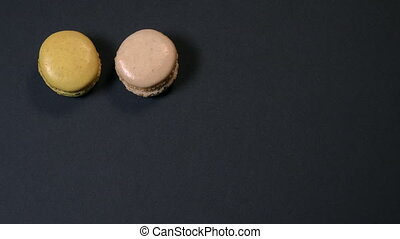 Stop Motion, Rows of a colorful macaroons on a black table