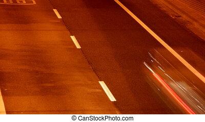 stop motion urban scene of traffic on a major road at dusk in barcelona, spain