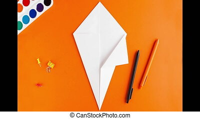 Stop motion video step-by-step instructions for Halloween. origami instructions. How to make a Ghost out of paper. the concept of Halloween. Simple crafts creative idea. High quality FullHD footage