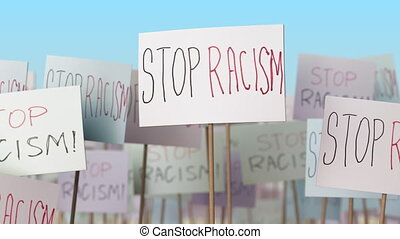 STOP RACISM placards at street demonstration. Conceptual loopable animation