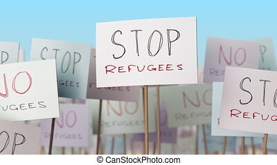 STOP REFUGEES placards at street demonstration. Conceptual...