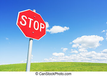 Stop road sign against blue sky
