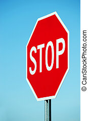 stop sign against blue sky