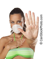 stop sign and breathing mask - beautiful brunette with a...