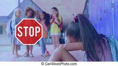 Stop sign and girl crying in school against flickering background