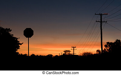 Stop sign at sunset