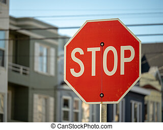 Stop sign in a residential neighborhood with copy space to...