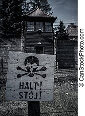 Stop sign in former Nazi concentration camp Auschwitz I,...