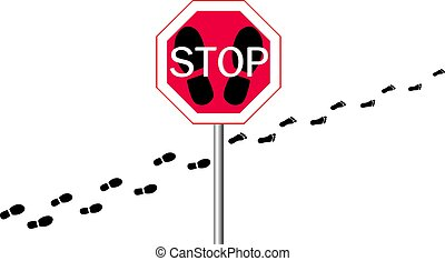 stop sign on a with footprints from shoes and legs