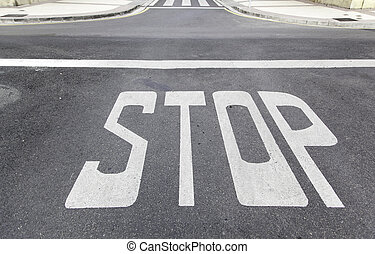Stop sign on asphalt