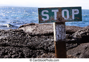 Stop Sign on Cliff Edge