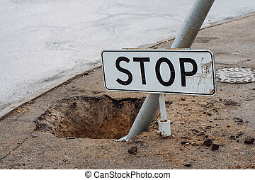 Stop sign on the ground