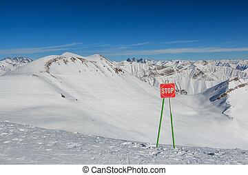 Stop sign on the ski slopes