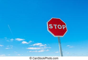 Stop sign over blue sky background