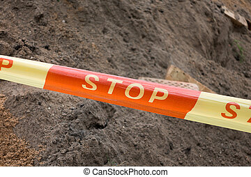 stop sign ribbon on the construction site